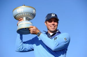 Matt Kuchar lifting the trophy after a strenuous week