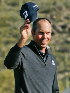 Kuchar showing off his wonderful bald nut.
