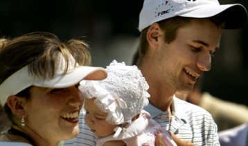 Sean O'Hair holding his 4-month year-old baby with his wife. Bless