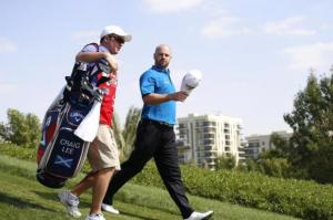 Lee of Scotland walks on the third hole during the Abu Dhabi Golf championship