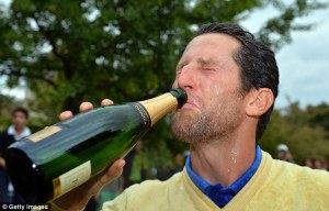 Enjoying his champagne... Courtesy of GettyImages